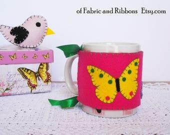 Felt Cup Cozy. Felt fuchsia cup cosy with butterfly and flowers. Fuchsia cup cosy with flowers.