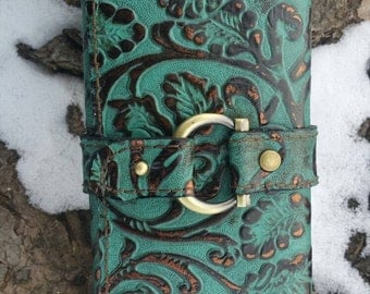 Women's embossed clutch with matching wristlet