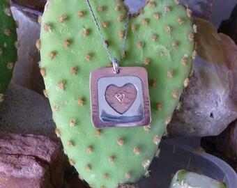 Square copper pendant with heart design