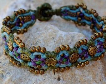 Handmade wave design, unique,blue, purple,macrame bracelet with solid brass beads.