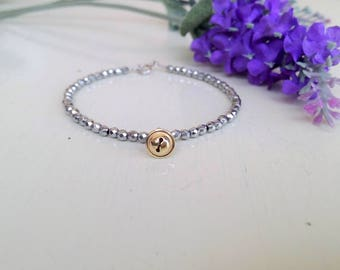 silver bracelet, beaded bracelet, four leaf clover, bell gold
