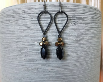 Black teardrop earrings with jet black and gold drops