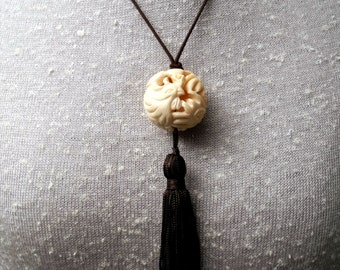 One of a Kind Tassel Necklace with Intricately Carved Ivory Bone Bead Depicting  a Crested Bird with Long Tail Feathers, Brown Silk Tassel