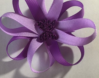 Purple flower and butterfly hair bow