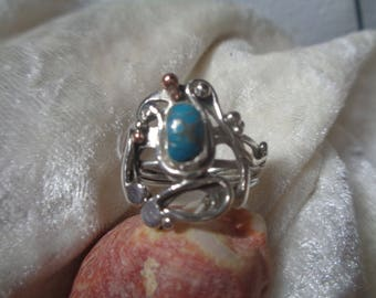 Ring with turquoise, silver and copper accents