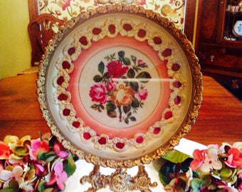 Petit point in antique gold round frame