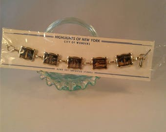 Vintage New York city souvenir bracelet. Rockefeller Center, International Airport, Empire State Building, Coney Island, Statue of Liberty!