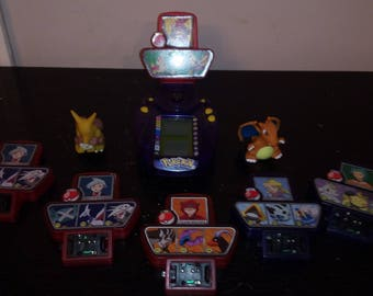 pokemon trainers handheld game w/ 5 cartridges and 2 figures
