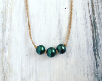 Emerald green pearl necklace with puka shell closure - handmade in Hawaii