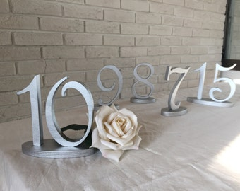 Wedd Table numbers pictured in Gold and Silver. Table numbers available multiple colors Table numbers Glitter numbers wedding