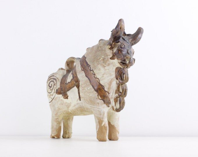 Handcrafted ceramic Bull, statue figurine of a stylized bull, Pucara Peruvian Andean traditional folklore myth storytelling