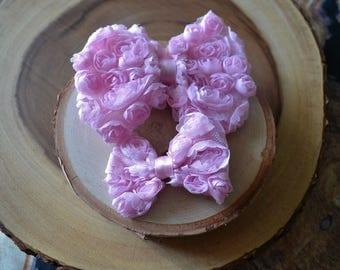 Pink rosette bow hairclip set