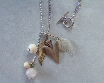 Sterling Silver Arrowhead Necklace with feather leaf glass bead accents 23""