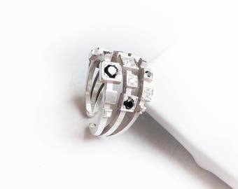 Mondrian-06: square ring - sterling silver. Black and white Zircon stones.
