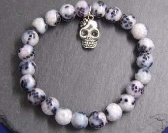 B1234  Light and Dark Purple Stone Bracelet with Skull Charm.