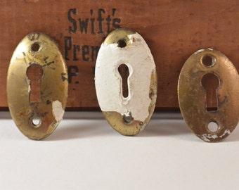 Set of Three Brass Keyholes