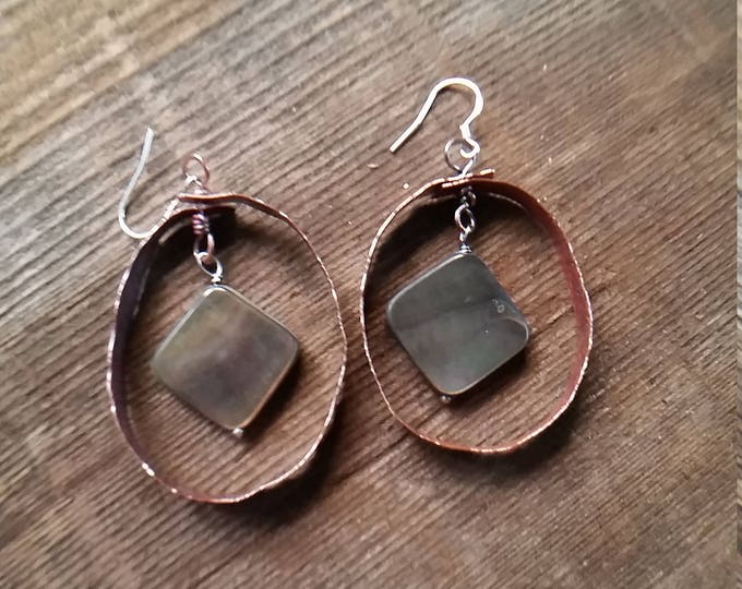 Copper Hoops, Hammered, Texture, and Heated for Patina. The drop is a Dark Mother of Pearl with lots of Colors Reflected in Them.