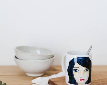Cup ceramic with illustration of female face