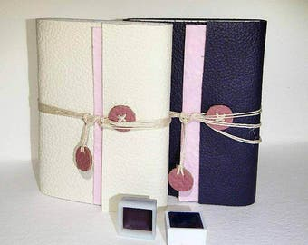 Two halfpans of handmade watercolourpaints and genuine leather journals; the Romantic Duo.