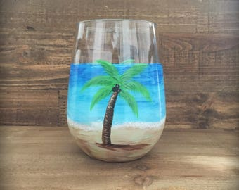 Hand painted island beach paradise palm trees on a stemless wine glass