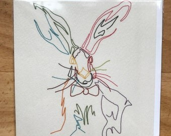 Embroidered hare with a bow greeting card