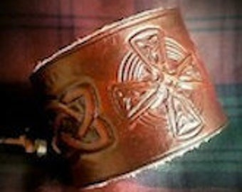 Celtic cross with knotwork leather wrist cuff