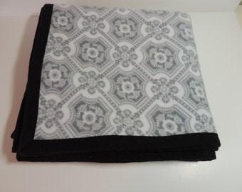 Grey, white and black fleece blanket