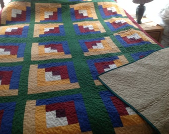 Twin log cabin homemade quilt.