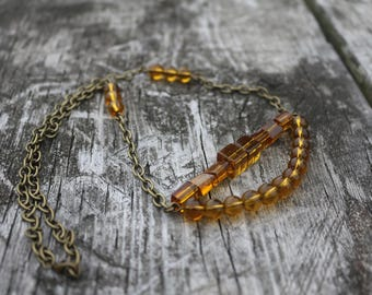 Beaded Arc necklace || Antiqued brass chain