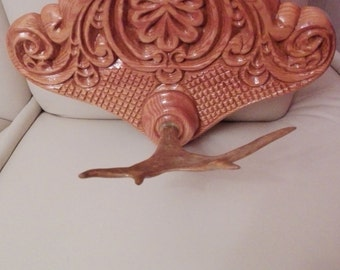 Wood carving, souvenir, wall decoration with natural horn deer