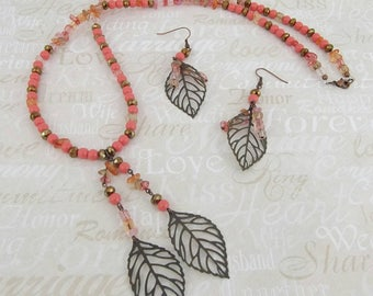 Coral pink and copper colored jewelry set.