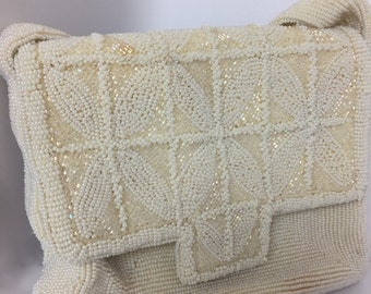 Small white bead embroidered purse