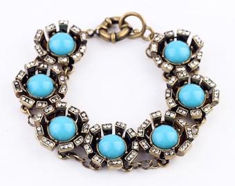 Turquoise and rhinestone statement bracelet