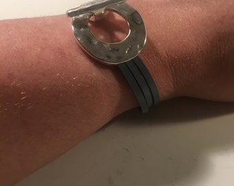 Grey leather and silver plate round toggle clasp bracelet