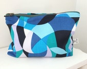 Multi Blue wet bathing suit bag with hot pink PUL lining.  Water resistant zipper pouch.