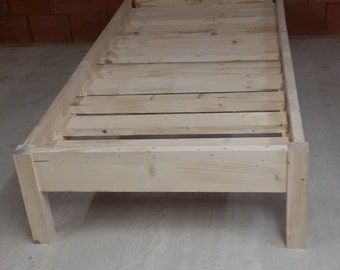 Low single bed suitable for a headboard