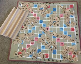 100 1989 scrabble letters and 4 trays