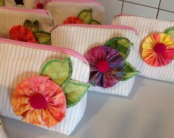 Clutch bag with flower