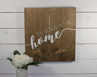 It's good to be home, wooden sign