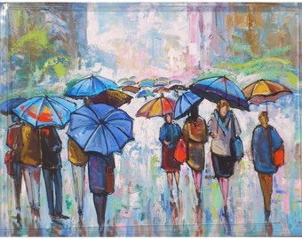 people walking under the rain with blue umbrellas