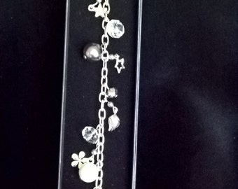 Charm bracelet with silver plated charms and pewter coloured beads