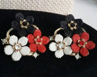 Red black and white enamel flowers on metal pierced earrings  vintage