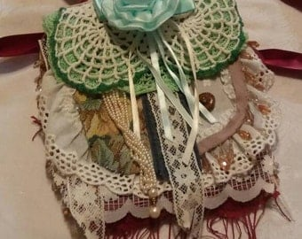 Cute, feminine handbag.  Lots of lace, doilies, vintage jewelry and ribbon. Cute for a young girly girl or a feminine mom.