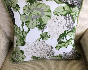 Floral pillow cover with braided cord trim