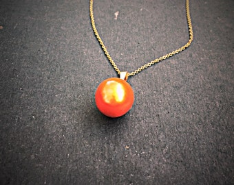 Orange pearl pendant necklace with a gold chain