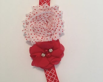 A sweet red and white headband with rhinestones and pearls