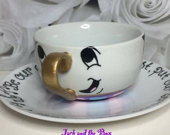 Chip hand painted teacup and saucer
