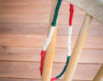 Upcycling chain made of wool in green, red and white, with beads from the inside
