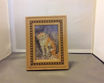 From 'Themes and Foundations of Art' in inlaid wood frame