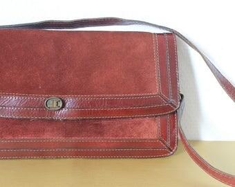 Dark red leather vintage handbag with dark golden accent